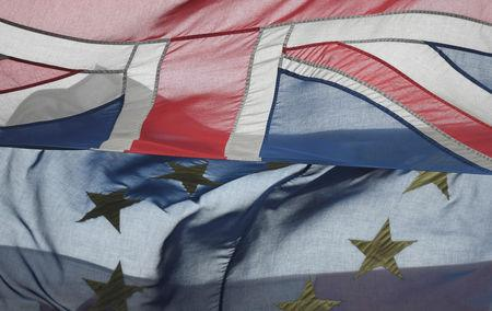 European Union and British Union flags are seen blowing in the wind in London, Britain