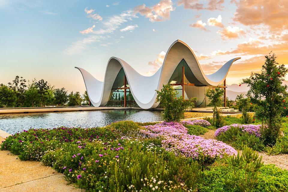 "<p>Deep within South Africa's wine country, an eye-catching chapel by Coetzee Steyn of <a href=""http://www.steynstudio.com/"" rel=""nofollow noopener"" target=""_blank"" data-ylk=""slk:Steyn Studio"" class=""link rapid-noclick-resp"">Steyn Studio</a> seamlessly blends Cape Dutch architecture with modern, more sustainable style. The curvaceous cast-concrete shell evokes the surrounding Waaihoek Mountains and pays tribute to the historic gables in the rural communities of the Western Cape. In order to keep the structure's sculptural appearance sound, Steyn cleverly hid supportive elements in the plinth and inside the outer corners of the neighboring garden.</p>"