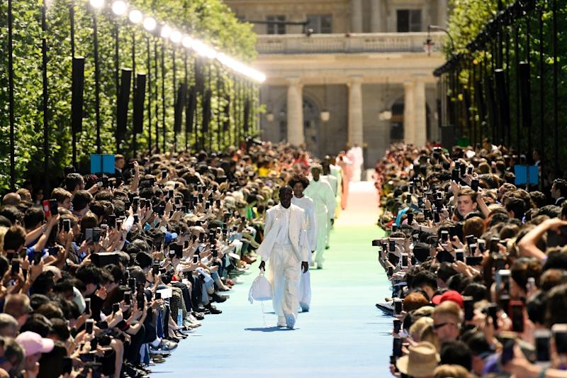 Models present creations by new Louis Vuitton designer Virgil Abloh in Paris on Thursday watched by celebrities Kanye West, Kim Kardashian and Rihanna (AFP Photo/BERTRAND GUAY)