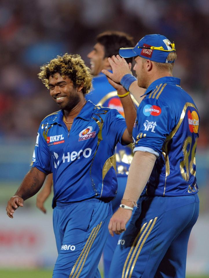 Mumbai Indians bowler Latish Malinga(R) celebrates the wicket of Deccan Chargers Ravi Teja during the IPL Twenty20 cricket match between Deccan Chargers and Mumbai Indians at Dr. Y.S. Rajasekhara Reddy Cricket Stadium in Visakhapatnam on April 9, 2012. AFP PHOTO / Noah SEELAM.RESTRICTED TO EDITORIAL USE. MOBILE USE WITHIN NEWS PACKAGE. . (Photo credit should read NOAH SEELAM/AFP/Getty Images)