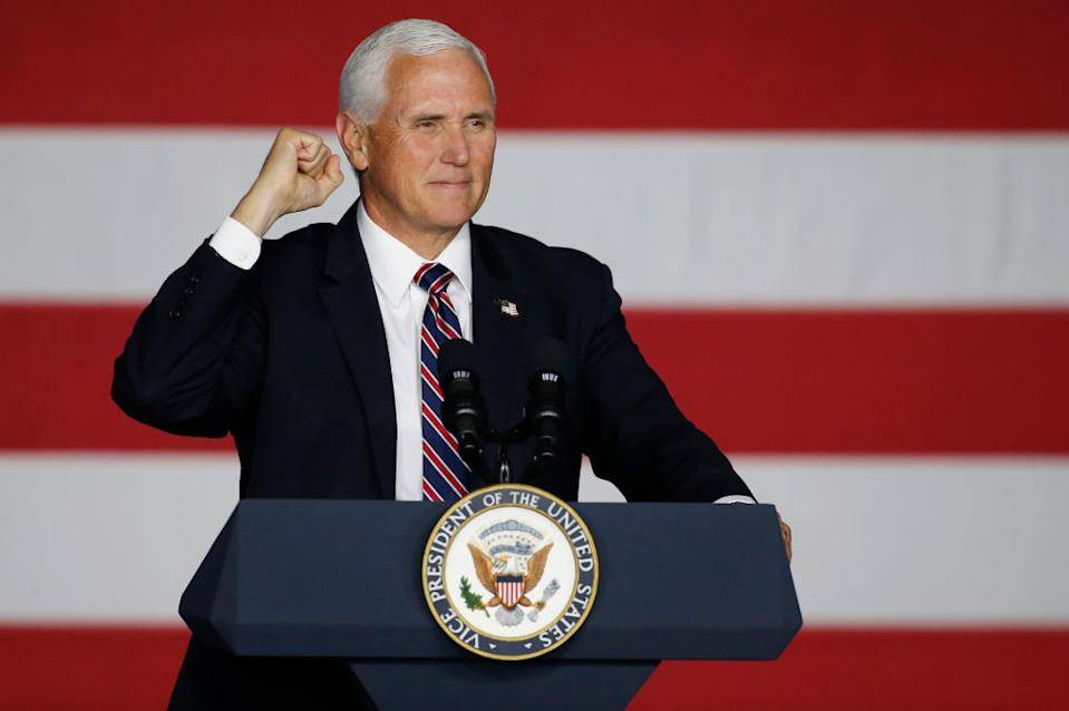 Vice President Mike Pence gestures as he speaks to a crowd.