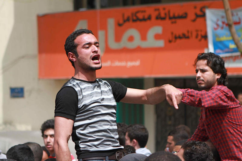 FILE - In this April 1, 2011 photo, activist Ahmed Douma chants slogans during a march to Tahrir Square demanding the prosecution of members of former President Hosni Mubarak's government in Cairo, Egypt. On Monday, April 7, 2014, an Egyptian appeals court has upheld convictions and three-year sentences for three prominent activists — Ahmed Maher, Mohammed Adel and Ahmed Douma. The three were accused of violating a controversial new law on holding protests. The ruling is part of a crackdown by Egypt's military-backed government against the leaders of the 2011 uprising that toppled the regime of autocrat Hosni Mubarak. (AP Photo/Sarah Carr, File)