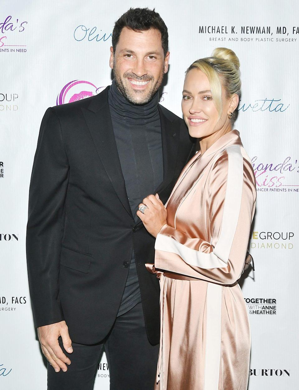 <p>Maks Chmerkovskiy and wife Peta Murgatroyd hit the red carpet at the Kiss the Stars Breast Cancer Awareness Cocktail Hour on Wednesday in West Hollywood. </p>