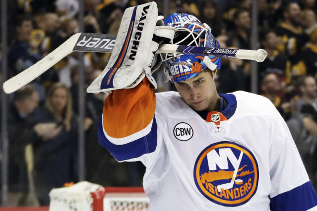 New York Islanders goaltender Thomas Greiss reacts after allowing a goal by Pittsburgh Penguins' Phil Kessel during the second period of an NHL hockey game in Pittsburgh, Thursday, Dec. 6, 2018. (AP Photo/Gene J. Puskar)