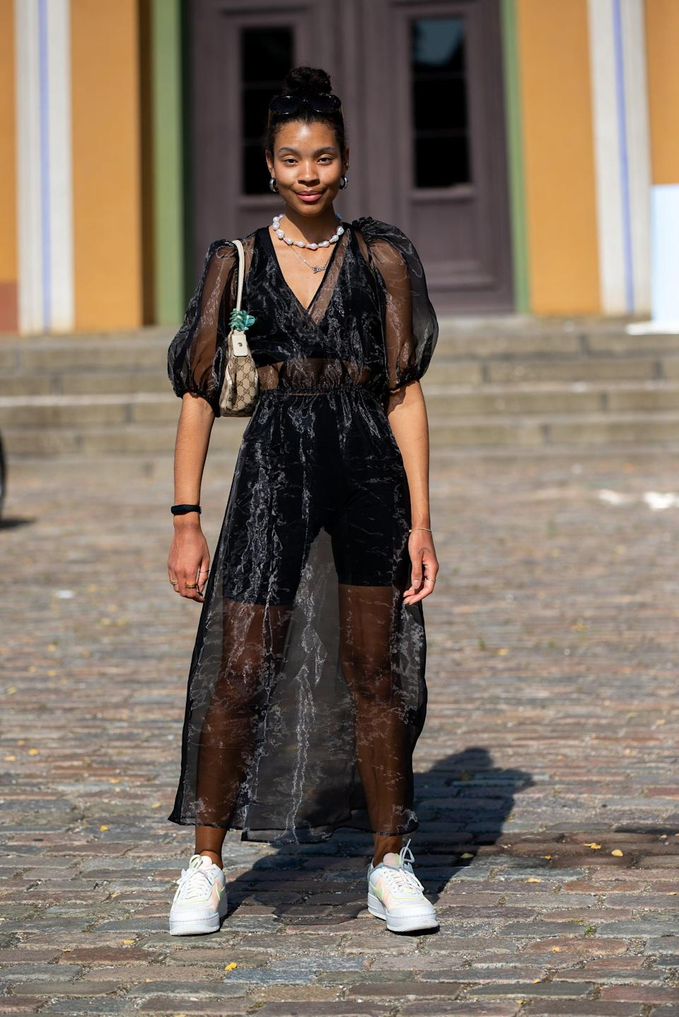 <p>Take any sheer dress and layer with a tank, bike shorts, and sneakers for a sporty look.</p>