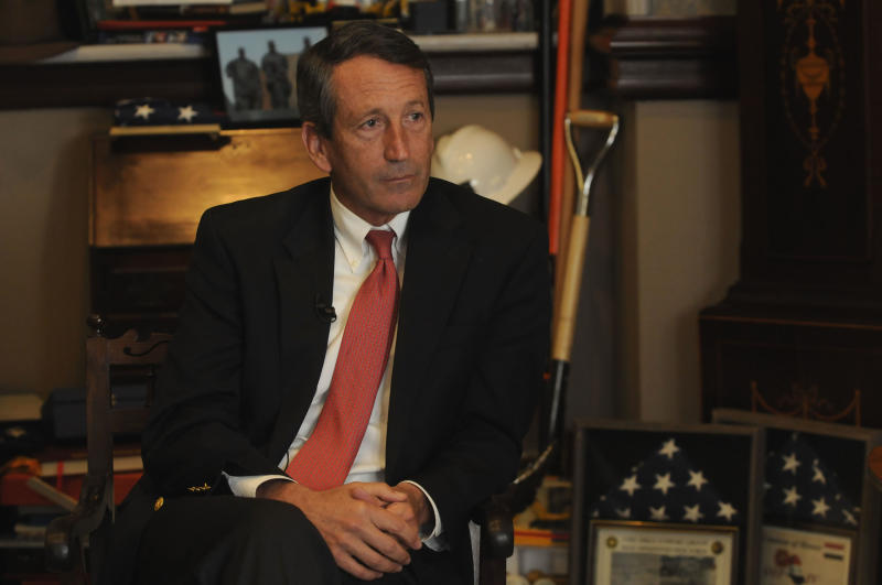 In this Tuesday, Dec. 14, 2010 photo, S.C. Gov. Mark Sanford talks with Associated Press reporters in his office in Columbia, S.C. about his time in office and his future. (AP Photo/Virginia Postic)