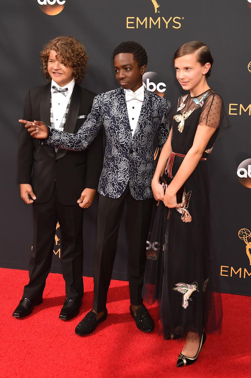 LOS ANGELES, CA - SEPTEMBER 18: (L-R) Actors Gaten Matarazzo, Caleb McLaughlin, and Millie Bobby Brown attend the 68th Annual Primetime Emmy Awards at Microsoft Theater on September 18, 2016 in Los Angeles, California. (Photo by Jeff Kravitz/FilmMagic)
