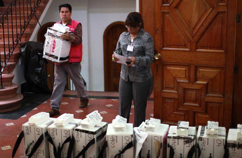 Ballot boxes are brought to an electoral institute district council to be computed in Mexico City, Wednesday July 4, 2012. The computation is done to determine which ballot boxes used in last Sunday's general elections will be recounted in front of party representatives. (AP Photo/Dario Lopez-Mills)