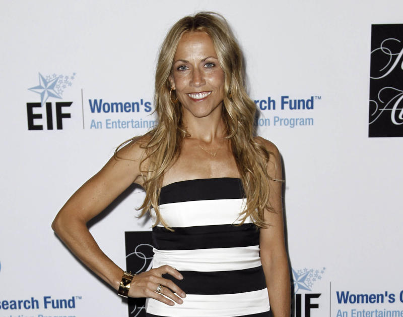 """FILE - This April 18, 2012 file photo shows musician Sheryl Crow at the Entertainment Industry Foundation's """"Unforgettable Evening"""" in Beverly Hills, Calif.  A judge granted Crow a temporary restraining order against Phillip Gordon Sparks on Tuesday July 24, 2012 in response to online rants and a threat he made publicly to """"just shoot"""" the Grammy winner. (AP Photo/Matt Sayles, file)"""