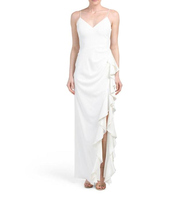 "<p>V-neck Side Ruffle Gown, $180,<a href=""https://tjmaxx.tjx.com/store/jump/product/women-women-dresses-wedding-bride/V-neck-Side-Ruffle-Gown/1000347712?colorId=NS4484166&pos=1:12&N=2497926153"" rel=""nofollow noopener"" target=""_blank"" data-ylk=""slk:tjmaxx.tjx.com"" class=""link rapid-noclick-resp""> tjmaxx.tjx.com</a> </p>"