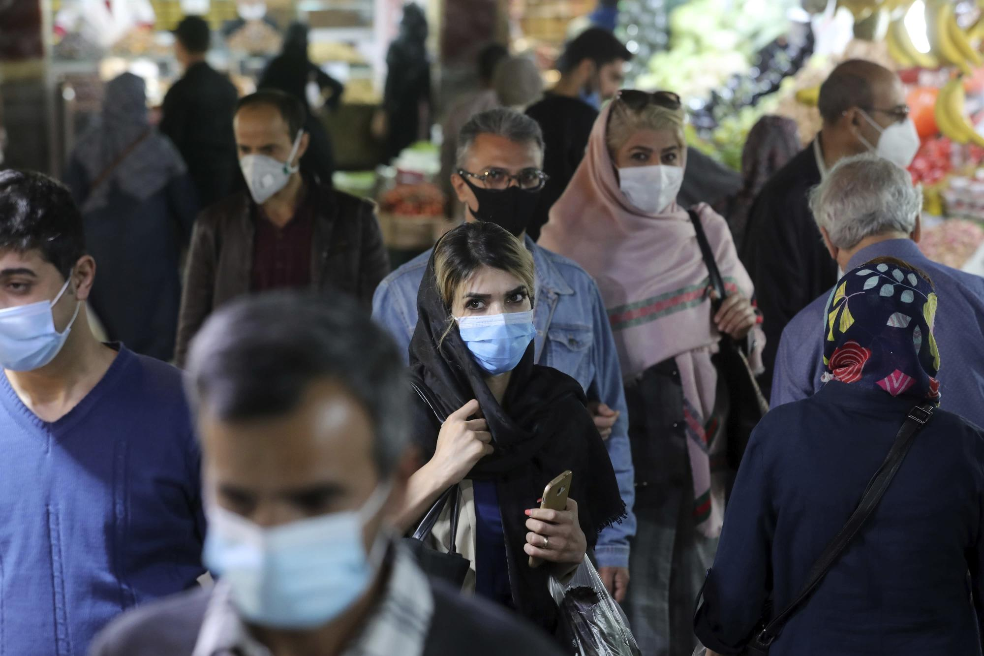 Wary of angering public, Iran has few ways to contain virus