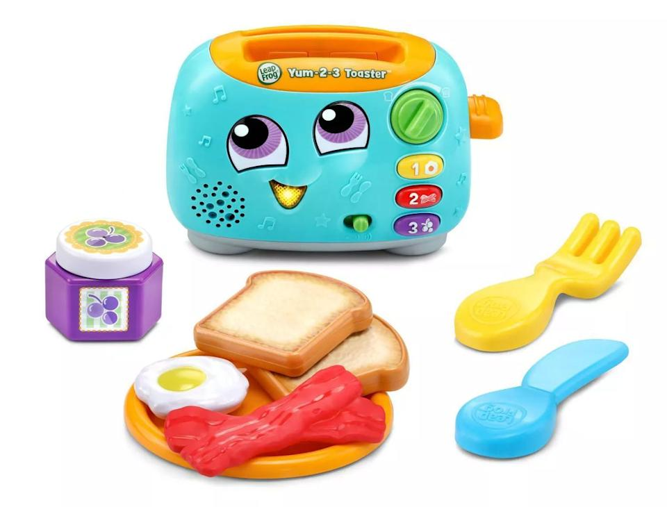 """This talking and singing appliance will help your kidlearn all about numbers, colors and the most important meal of the day! (Note: This requires two <a href=""""https://amzn.to/3gAeXrs"""" target=""""_blank"""" rel=""""noopener noreferrer"""">AAA batteries</a>.)<br /><br /><strong>Promising review:</strong> """"This is the greatest thing ever! YUM toaster for life!"""" —<a href=""""https://amzn.to/2PfN2Sw"""" target=""""_blank"""" rel=""""noopener noreferrer"""" data-a-size=""""small"""">Sophia</a><br /><br /><strong>Get it from Amazon for<a href=""""https://amzn.to/3xeGR29"""" target=""""_blank"""" rel=""""noopener noreferrer"""">$23.89</a>.</strong>"""