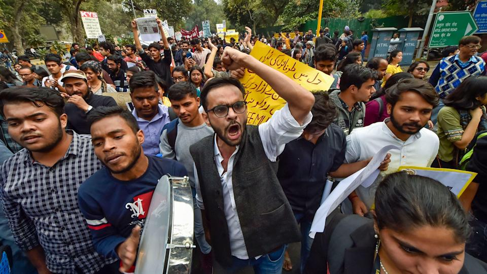 """<div class=""""paragraphs""""><p>Umar Khalid with fellow protesters gathered at the Mandi House during an anti-CAA protest before the riots.</p></div>"""