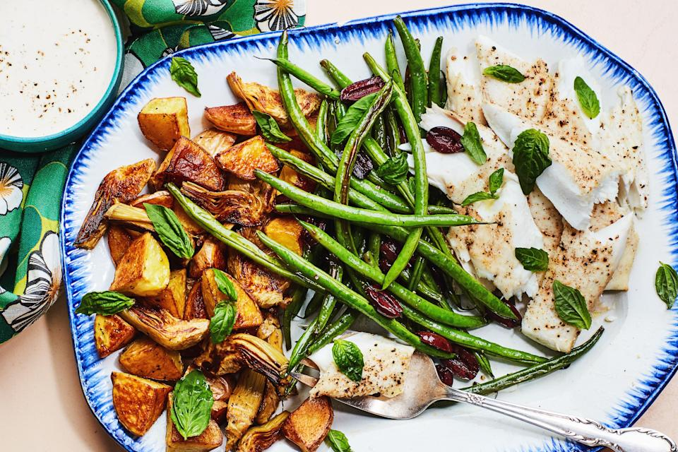 "Jarred marinated artichoke hearts get super-crispy and delicious when roasted, making them the secret star of this simple sheet-pan dinner, which you can get on the table in under an hour. <a href=""https://www.epicurious.com/recipes/food/views/roasted-nicoise-salad-with-halibut-green-beans-potatoes-artichoke-hearts?mbid=synd_yahoo_rss"" rel=""nofollow noopener"" target=""_blank"" data-ylk=""slk:See recipe."" class=""link rapid-noclick-resp"">See recipe.</a>"