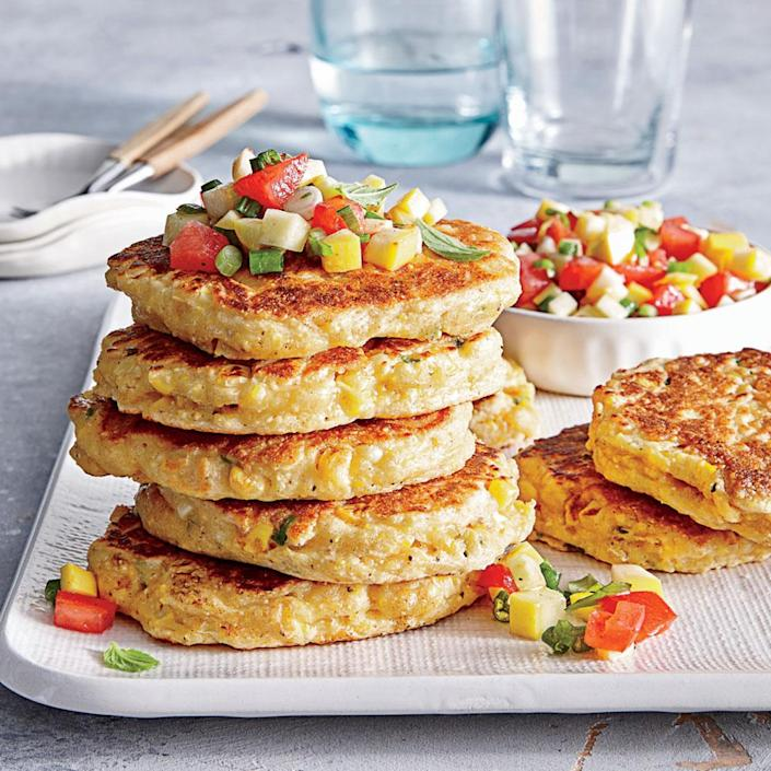 """<p>This speedy vegetarian entrée is absolutely bursting with peak-season produce. Side suggestion: an herby white bean and arugula salad.</p> <p> <a rel=""""nofollow noopener"""" href=""""http://www.myrecipes.com/recipe/fresh-corn-cakes-summer-salsa"""" target=""""_blank"""" data-ylk=""""slk:View Recipe: Fresh Corn Cakes with Summer Salsa"""" class=""""link rapid-noclick-resp"""">View Recipe: Fresh Corn Cakes with Summer Salsa</a></p>"""