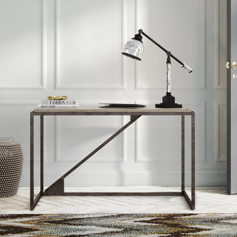 """This sleek beauty is 70 percent off—and just the desk for you if your """"home office"""" is also your bedroom or living room. (Photo: Wayfair)"""