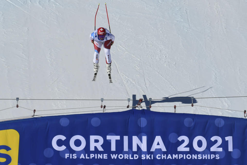 Switzerland's Beat Feuz competes during the men's downhill, at the alpine ski World Championships in Cortina d'Ampezzo, Italy, Sunday, Feb.14, 2021. (AP Photo/Marco Tacca)