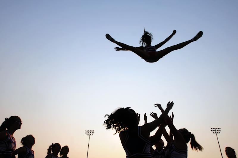 Cheerleading needs sports safety rules, docs say