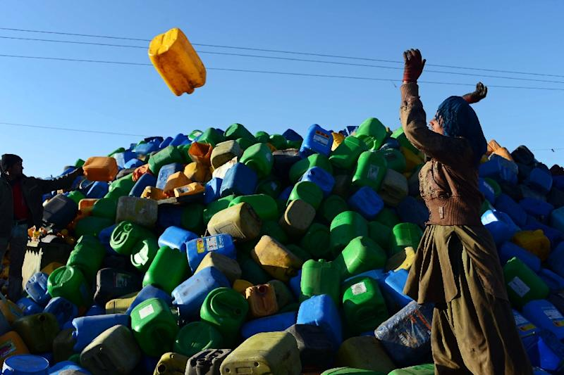 Afghan labourers work at a plastics recycling factory in Herat (AFP Photo/Aref Karimi)