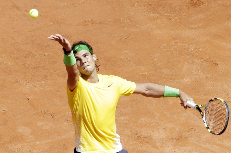 Spain's Rafael Nadal serves the ball to Italy's Paolo Lorenzi during the Italian Open tennis tournament match, in Rome, Wednesday, May 11, 2011. (AP Photo/Riccardo De Luca)