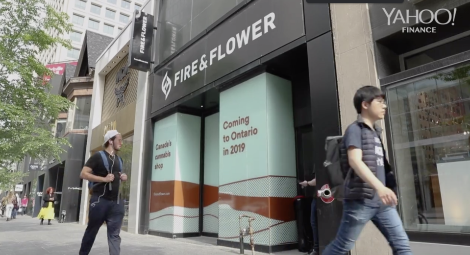 Pedestrians pass the yet-to-be-opened Fire & Flower cannabis store in Toronto's luxury shopping district in June 2019. (Yahoo Finance Canada)
