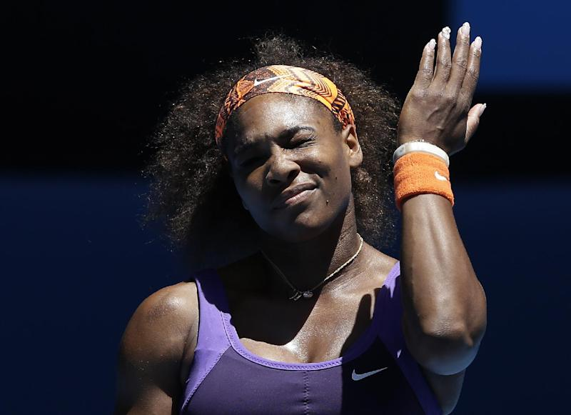 Serena Williams of the US reacts during her quarterfinal match against compatriot Sloane Stephens at the Australian Open tennis championship in Melbourne, Australia, Wednesday, Jan. 23, 2013. (AP Photo/Andy Wong)