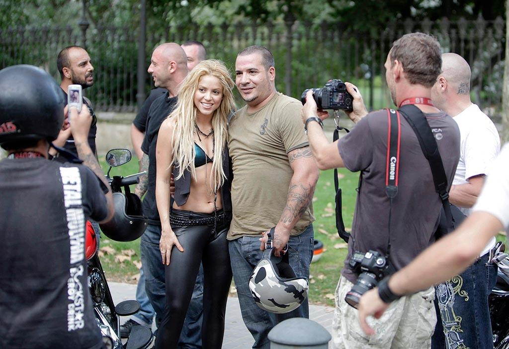 "The ""Waka Waka, This Time for Africa"" singer posed for photos on set with some of the ""Loca"" extras in between takes. OHPIX/<a href=""http://www.x17online.com"" target=""new"">X17 Online</a> - August 17, 2010"