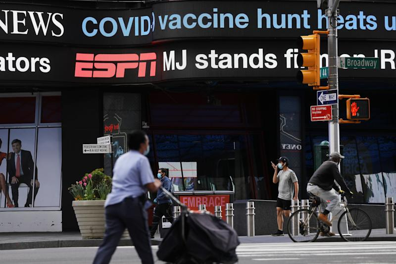 NEW YORK, NY - MAY 04: People walk through an empty Times Square on May 04, 2020 in New York City. Hospitals in New York are beginning to see a drop in news coronavirus cases as New York continues to be one of the global centers of the COVID-19 outbreak (Photo by Spencer Platt/Getty Images)