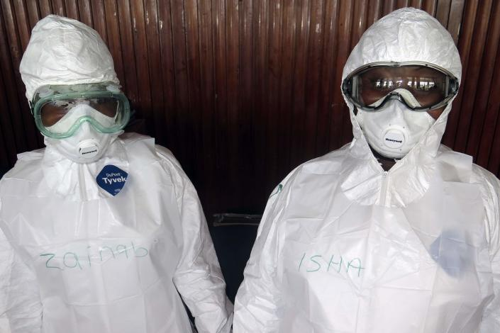 REFILE - CORRECTING COUNTRY IDENTIFIER AFTER BYLINE The names of trainee health workers are seen written on their protective suits at a World Health Organization (WHO) training session in Freetown September 30, 2014. The death toll from the world's worst Ebola outbreak on record reached 3,338 people out of 7,178 cases in West Africa as of Sept. 28, the World Health Organization said on Wednesday. Picture taken September 30. REUTERS/Umaru Fofana (SIERRA LEONE - Tags: HEALTH DISASTER)