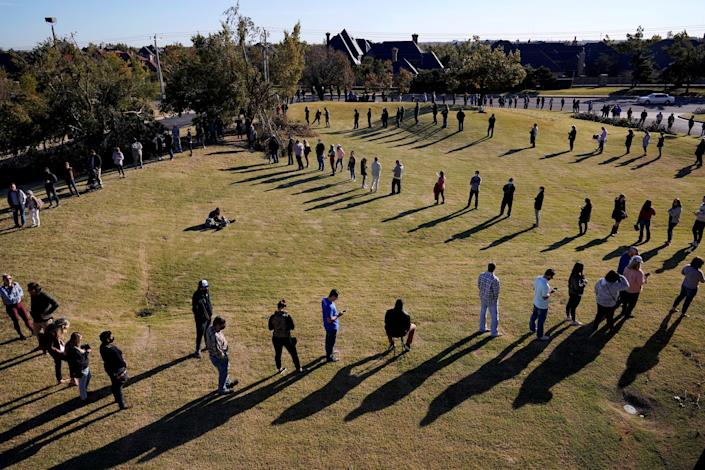 Voters wait in a long line to cast their ballots at Church of the Servant in Oklahoma City, Oklahoma U.S., November 3, 2020. REUTERS/Nick Oxford