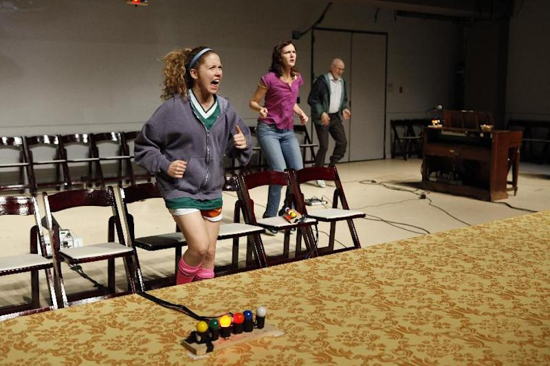 "This theater image released by Richard Kornberg & Associates shows, from left, Lisa Joyce, Christina Rouner and Michael Rudko, in a scene from Transport Group's production of Jonathan Franzen's ""House for Sale,"" performing off-Broadway at The Duke Theater in New York.  (AP Photo/Kornberg & Associates, Carol Rosegg)"