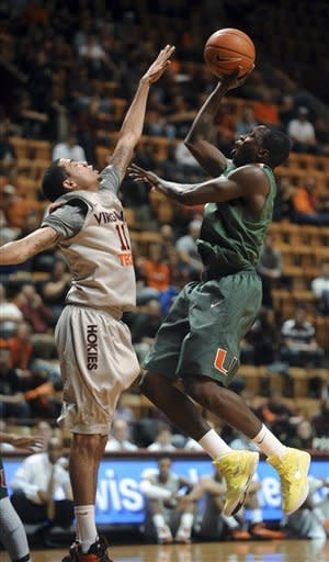 Miami's Durand Scott shoots over Virginia Tech's Erick Green during the first half of an NCAA college basketball game Wednesday, Jan. 30, 2013, at Cassell Coliseum in Blacksburg, Va. (AP Photo/Don Petersen)