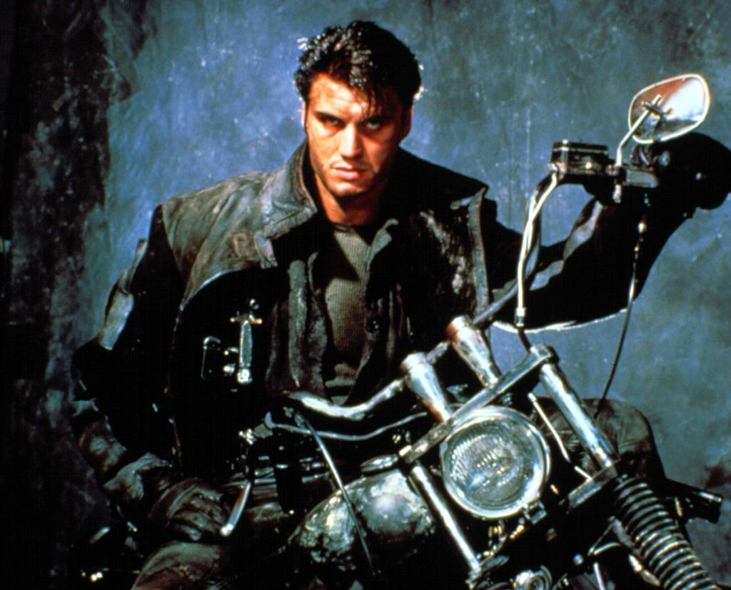 """<a href=""""http://movies.yahoo.com/movie/1800146842/info"""">THE PUNISHER</a>   In the movie's opening sequence, on a cinema marquee, you can see a poster for a film called """"Make Them Die Slowly."""" Coincidentally, this is how one feels while watching Dolph Lundgren as The Punisher."""