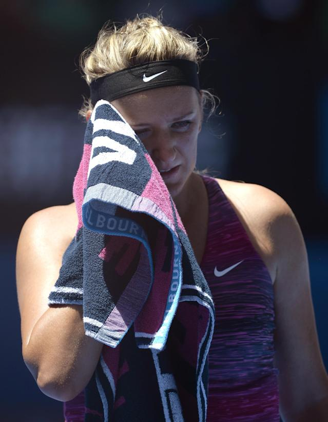 Victoria Azarenka of Belarus wipes the sweat from her face during her quarterfinal against Agnieszka Radwanska of Poland at the Australian Open tennis championship in Melbourne, Australia, Wednesday, Jan. 22, 2014.(AP Photo/Andrew Brownbill)