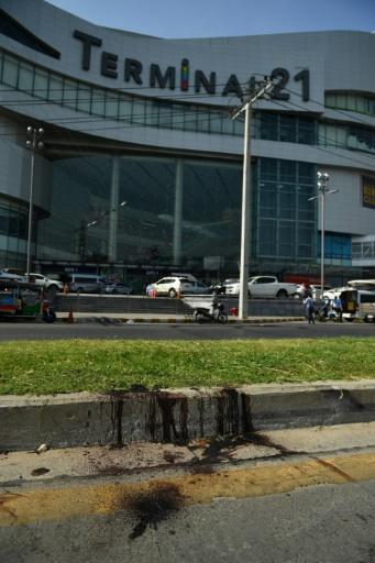 Blood stains the ground outside the mall after a 17-hour ordeal that left 29 victims dead