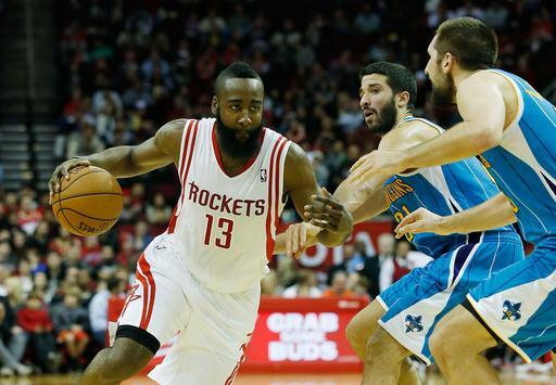 HOUSTON, TX - JANUARY 02: James Harden #13 of the Houston Rockets drives against Greivis Vasquez #21 and Ryan Anderson #33 of the New Orleans Hornets at Toyota Center on January 2, 2013 in Houston, Texas. (Photo by Scott Halleran/Getty Images)