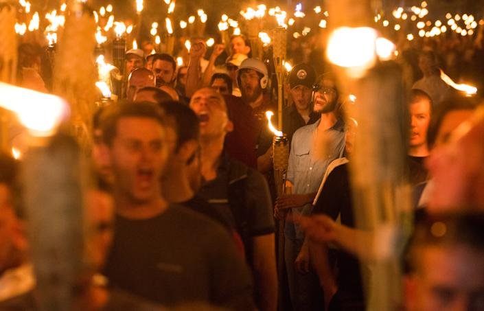Neo Nazis, Alt-Right, and White Supremacists take part a the night before the 'Unite the Right' rally in Charlottesville, VA, white supremacists march with tiki torchs through the University of Virginia campus.  (Zach D Roberts/NurPhoto via Getty Images)