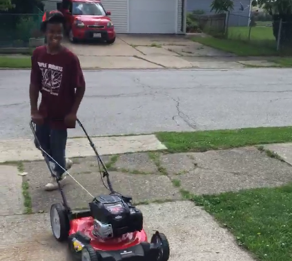 Reginald Fields, the 12-year-old who runs his own lawn care business, called Mr. Reggie's Lawn Cutting Service, smiles in a viral video posted by a happy customer. (Photo: Lucille Holt via Facebook)