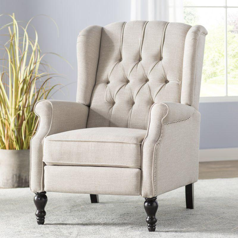 """<p>jossandmain.com</p><p><a href=""""https://go.redirectingat.com?id=74968X1596630&url=https%3A%2F%2Fwww.jossandmain.com%2Ffurniture%2Fpdp%2Fleonie-manual-recliner-j000210719.html&sref=https%3A%2F%2Fwww.countryliving.com%2Fhome-design%2Fg31785674%2Ftop-cozy-chairs%2F"""" rel=""""nofollow noopener"""" target=""""_blank"""" data-ylk=""""slk:CHECK PRICE"""" class=""""link rapid-noclick-resp"""">CHECK PRICE</a></p><p>Looking to add a recliner to your living room? Believe it or not, this pretty chair is just that—but your guests will be none the wiser.</p>"""
