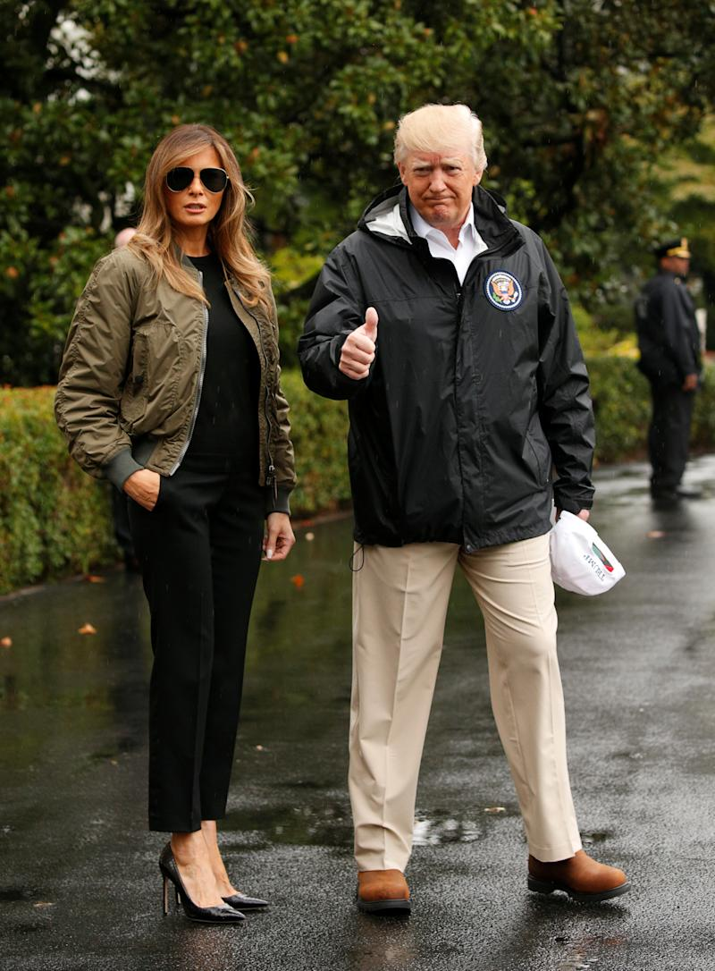 Some people took issue with first lady Melania Trump for wearing these high heels before boarding a flight with President Donald Trump from the White House to Texas on Tuesday. (Kevin Lamarque / Reuters)