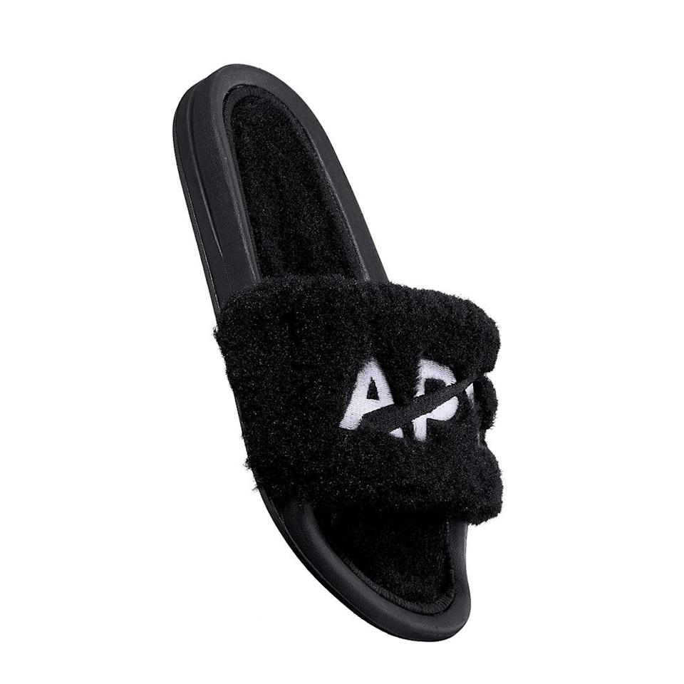 """<p>Rescue her from the ratty slippers she's been wearing since last March. APL's Shearling Slides feel like a hug for your feet — warm, cozy and ideal for whatever the day brings you, whether that's walking to the door to pick-up your take-out, or maybe even stepping outside to grab the mail. They come in multiple colors, and most importantly, they're machine washable, which is a crucial quality in daily-use footwear. </p> <p><b>Buy It! </b>$150, <a href=""""https://click.linksynergy.com/deeplink?id=93xLBvPhAeE&mid=41446&murl=https%3A%2F%2Fwww.athleticpropulsionlabs.com%2Fcollections%2Fwomens-slide%2Fproducts%2Fwomens-shearling-slide-black-white&u1=PEOTheBestValentinesGiftsforYourFavoriteGirlssdodd1271LifGal12563530202102I"""" rel=""""nofollow noopener"""" target=""""_blank"""" data-ylk=""""slk:athleticpropulsionlabs.com"""" class=""""link rapid-noclick-resp"""">athleticpropulsionlabs.com</a></p>"""