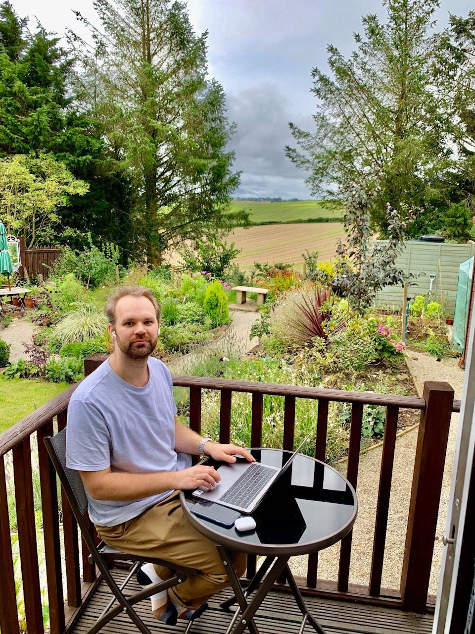 Konrad working from the garden of their Airbnb. (Photo: Christian Azolan)