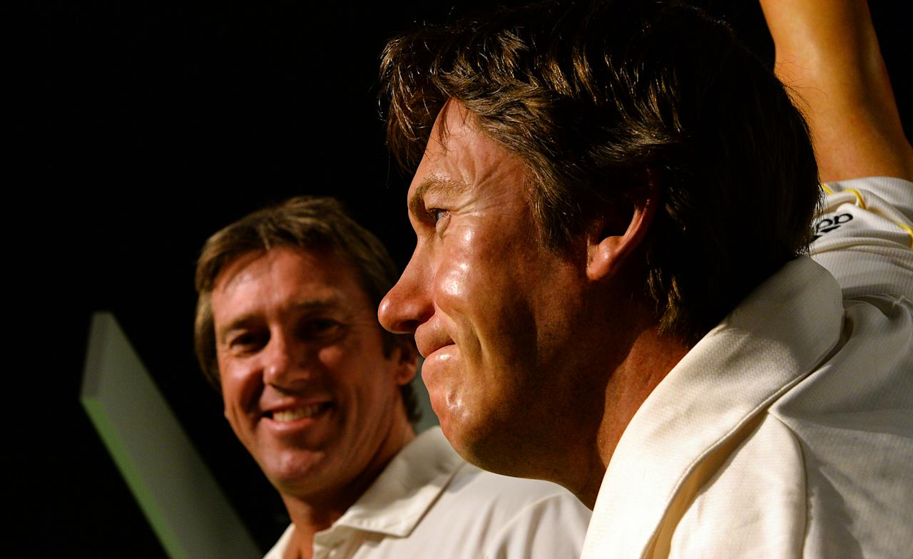 Australia's cricket legend Glenn McGrath (L) looks at the launch of his wax figure (R) at Madame Tussauds in Sydney on July 31, 2013. McGrath was the winner of the Madame Tussauds Sydney Aussie votes campaign where the Australian public was asked to cast their votes on which Australian sporting hero they wanted to see immortalised in wax.     AFP PHOTO / Saeed Khan        (Photo credit should read SAEED KHAN/AFP/Getty Images)