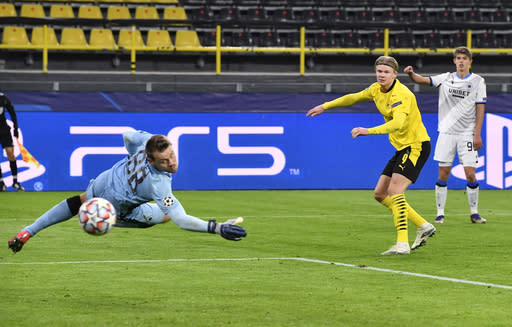 Dortmund's Erling Braut Haaland shoots to score his second goal during the Champions League group F soccer match between Borussia Dortmund and Club Brugge in Dortmund, Germany, Tuesday, Nov. 24, 2020. (AP Photo/Martin Meissner)