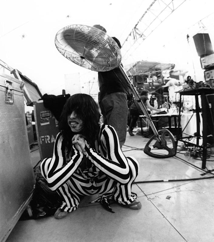 <p>Aerosmith lead singer, Steven Tyler, cools himself off backstage after a performance at the RFK Stadium in 1976. </p>