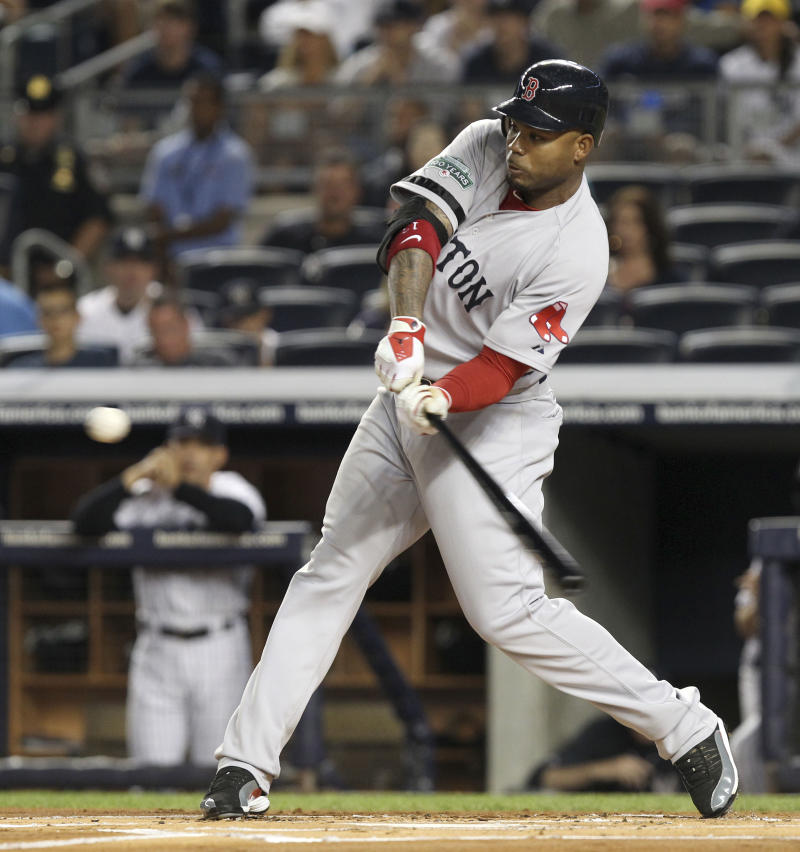 Boston Red Sox's Carl Crawford bats during the first inning of the baseball game against the New York Yankees Sunday, Aug. 19, 2012 at Yankee Stadium in New York.  (AP Photo/Seth Wenig)