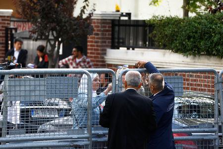 Officials are seen next to the barriers at the gate of Saudi Arabia's consulate in Istanbul, Turkey, October 10, 2018. REUTERS/Osman Orsal