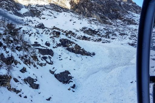 View from a helicopter of the avalanche site. Drones have also been deployed in the search, which has been hampered by deep snow