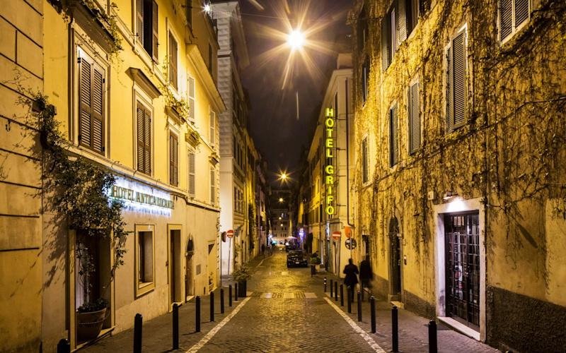 Yellow sodium street lights illuminate a street in the Monti neighborhood in Rome, March 20, 2017 - Credit: GIANNI CIPRIANO/New York Times / Redux / eyevine