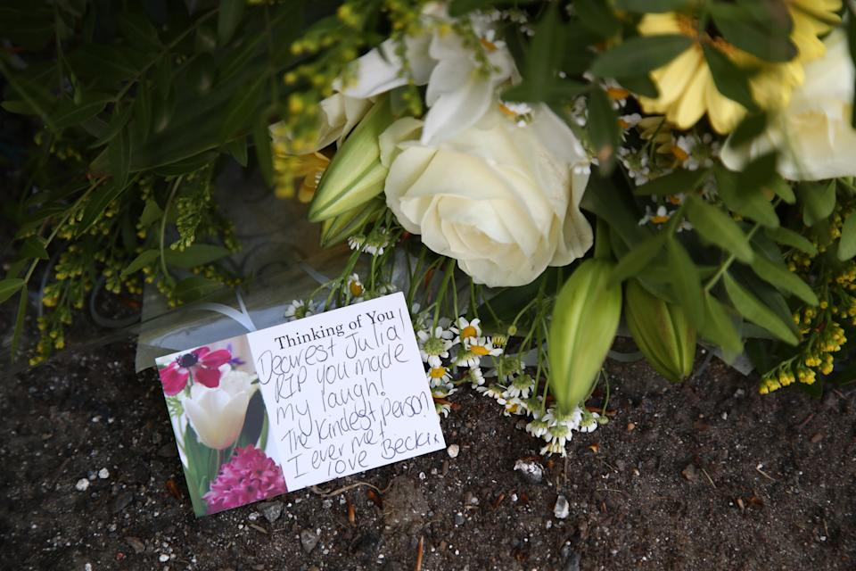 A floral tribute and message left close to the scene in Snowdown, Kent, where the body of PCSO Julia James was found. Kent Police have launched a murder enquiry following the discovery of the 53-year-old community support officer on Tuesday. Picture date: Thursday April 29, 2021.